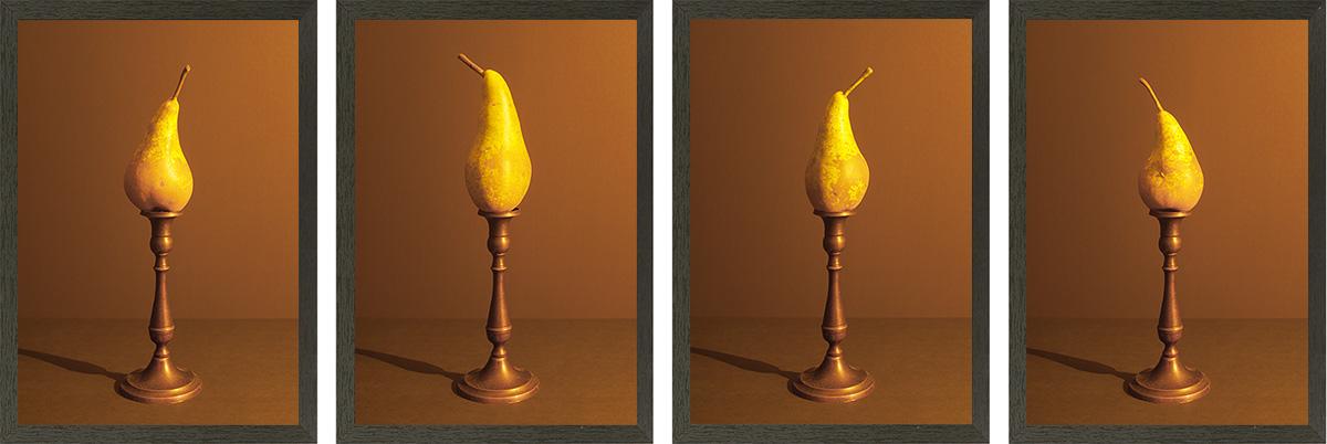 4 peren op een rij aangelicht door kaarslicht